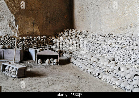 Skulls, bones, Fontanelle cemetery, historic cemetery in an underground cave system, Naples, Campania, Italy - Stock Photo