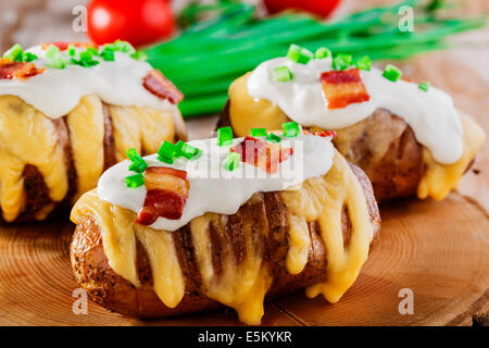 baked potato with cheese and sauce - Stock Photo