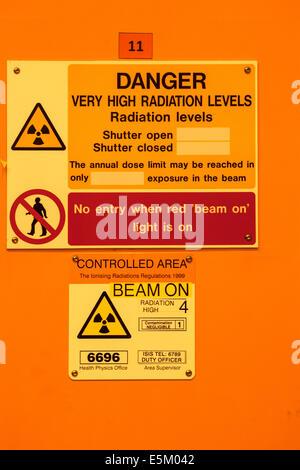 Radiation warning outside a laboratory in a scientific reseach establishment. - Stock Photo