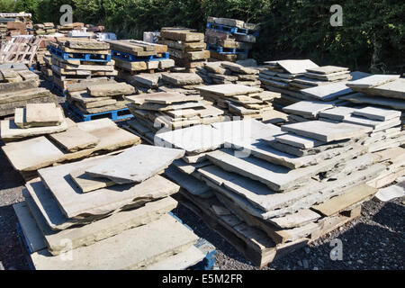 Old stone slabs at an architectural reclamation yard, UK - Stock Photo