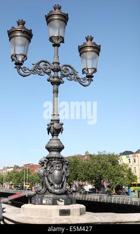 Victorian triple lamp on O'connell bridge Dublin - Stock Photo
