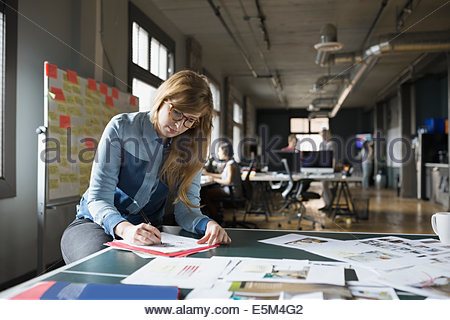 Creative businesswoman working in office - Stock Photo