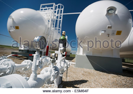 Gauge below natural gas containers - Stock Photo