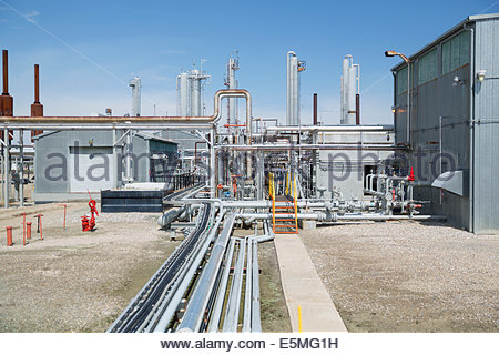 Pipes and equipment at gas plant - Stock Photo