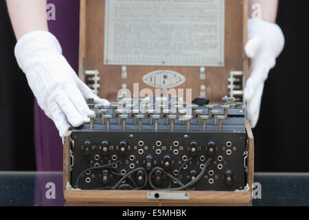 Auction house Christie's presents items from the 'Out of the Ordinary' sale, London, UK. German Enigma cipher machine - Stock Photo