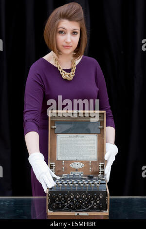 Auction house Christie's presents items from the 'Out of the Ordinary' sale, London, UK. German Enigma cipher machine. - Stock Photo