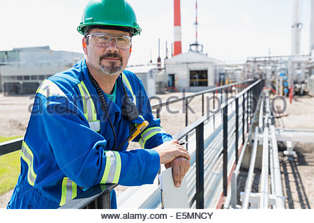 Portrait of worker on platform outside gas plant - Stock Photo