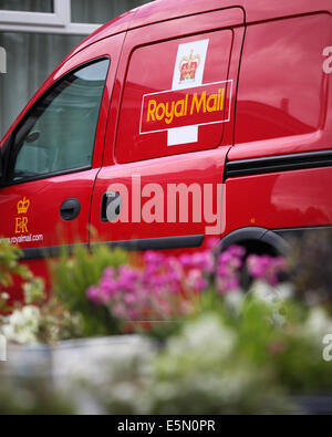 A Royal Mail delivery van parked outside the Royal British Legion in Old Basing, Hampshire, UK - Stock Photo