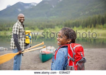 Father and daughter preparing to canoe - Stock Photo