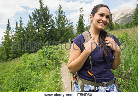 Smiling woman on hiking trail - Stock Photo