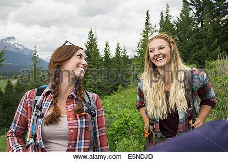 Friends hiking near mountain - Stock Photo