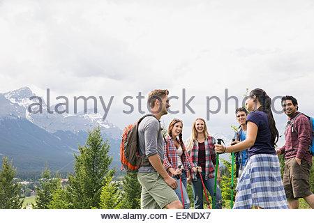 Friends hiking near mountains - Stock Photo