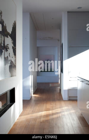 Open plan hallway detail with modern art in L House, Israel, Middle East. - Stock Photo