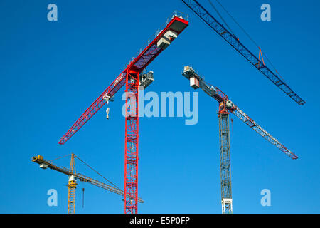 Construction cranes / tower crane against blue sky - Stock Photo