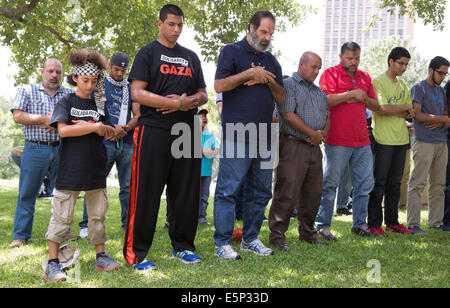 group of men pray at rally at Texas Capitol protesting Israel's siege of Gaza and the U.S support and funding of - Stock Photo
