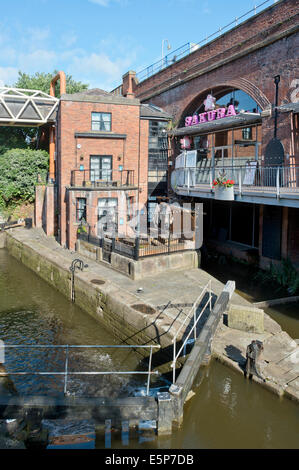 Sakura and another neighbouring bar in the summer sunshine at Deansgate Locks in Manchester. - Stock Photo