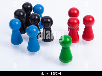 Image shows a group of colored people in a abstract arrangement - Stock Photo