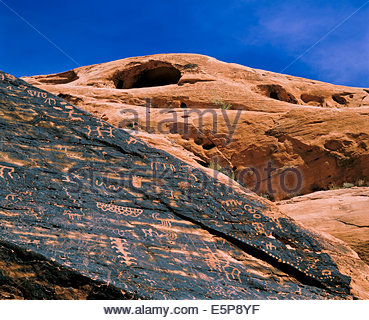 Petroglyphs carved in rock by prehistoric Anasazi indians in Valley of Fire State Park near Las Vegas Nevada USA - Stock Photo