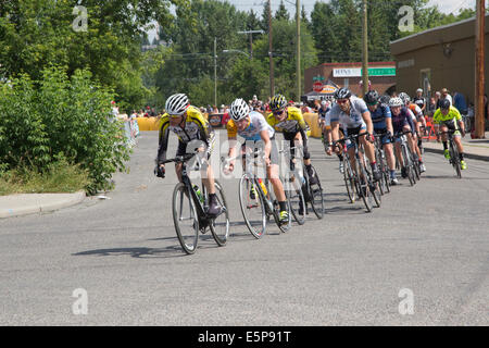 Alberta, Canada. 4th Aug, 2014.Racers speed around a corner on a lap of the Criterium in the community of Bowness - Stock Photo