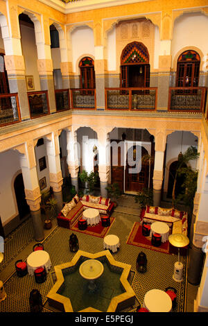 Riad Myra,Beautiful Carved stucco Cedar panels,Arches,Stone floors with intricate mosaics,Central Fountain,Rooftop,Fez,Morocco - Stock Photo