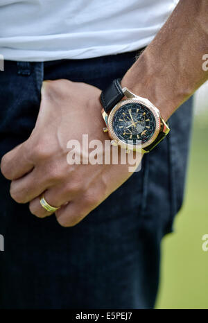 A man's hand with a Breitling watch and a wedding ring - Stock Photo