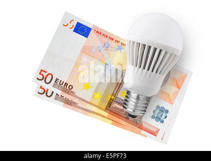 LED bulb over euro bills on white background - Stock Photo