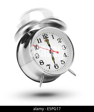 Ringing classical alarm clock isolated on white background - Stock Photo