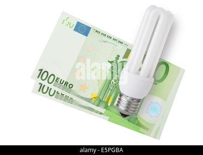 Energy saver bulb over euro bills on white background - Stock Photo