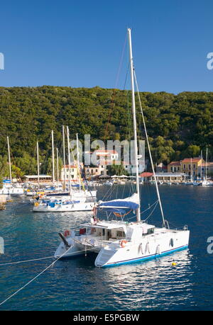 Yachts at anchor in the pretty harbour, Kioni, Ithaca (Ithaki), Ionian Islands, Greek Islands, Greece, Europe - Stock Photo