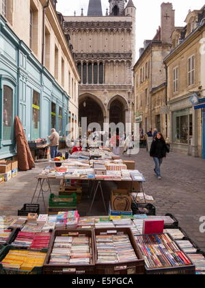 Booksellers' market stalls on Rue Musette and Church of Notre Dame, Dijon, Burgundy, France, Europe - Stock Photo