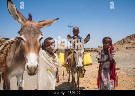 Happy young Bedouin children in the lowlands of Eritrea, Africa - Stock Photo