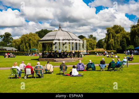 People watching a performance at the bandstand, Godalming, Surrey, England, United Kingdom, Europe - Stock Photo