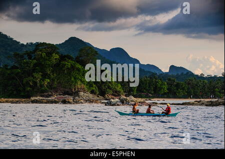 Outrigger cruising on the waters near the Puerto Princesa underground river, Palawan, Philippines, Southeast Asia, - Stock Photo