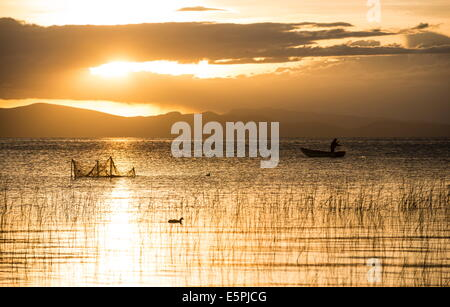 Sunset over Lake Titicaca, Copacabana, Lake Titicaca, Bolivia, South America - Stock Photo