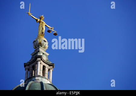 Scales of Justice above the Old Bailey Law Courts (Central Criminal Court) on former site of Newgate Prison, London, - Stock Photo