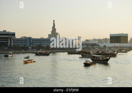 View from The Museum of Islamic Arts towards old Doha and The Islamic Centre with dhows moored in the Harbour, Doha, - Stock Photo