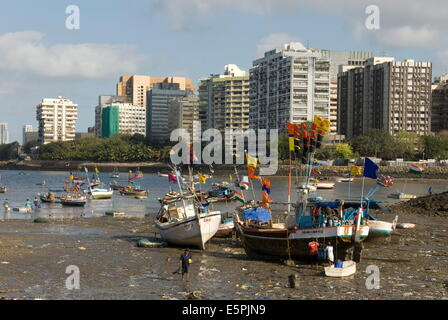 The beach in front of Colaba fishing village, with high-rises of Nariman Point across the bay, Mumbai, India, Asia - Stock Photo