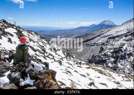 Woman on Mount Ruapehu looking towards Mount Ngauruhoe, Tongariro National Park, UNESCO Site, North Island, New - Stock Photo