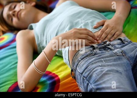 Teenage girl suffering from abdominal pain. - Stock Photo