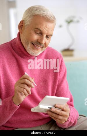 Man playing video game console. - Stock Photo