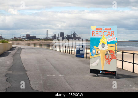 Sign Redcar lemon top ice cream with the steelworks in the background Redcar, Redcar and Cleveland, England, UK - Stock Photo