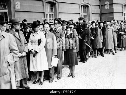 The picture from a Nazi news report shows people waiting in line at a theater box office in Berlin, Germany, June - Stock Photo