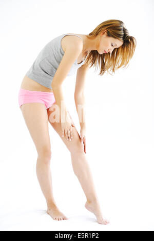Woman suffering from a pain in the knee. - Stock Photo