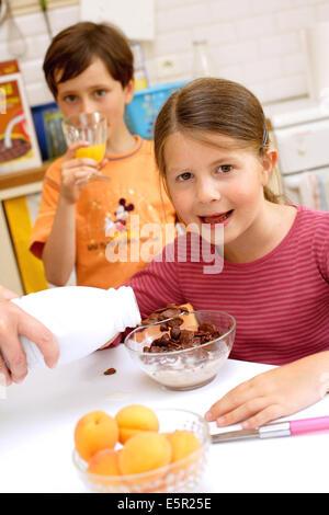 Children having breakfast. - Stock Photo