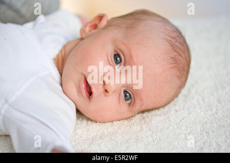 A one month old newborn baby displaying the 'Moro' Reflex ...