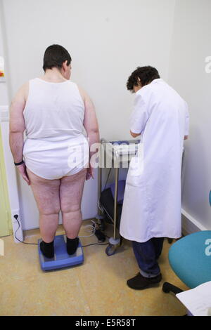Obese patient being weighed during medical consultation. Department of Nutrition of Pr Basdevant, Endocrinology - Stock Photo