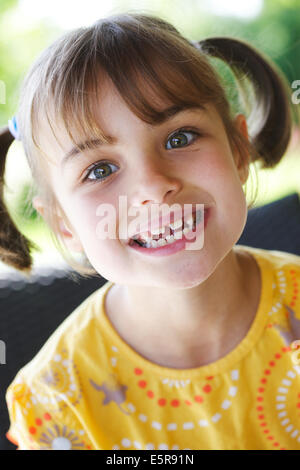 7 year old girl with milk teeth. - Stock Photo