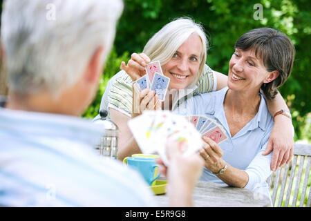 Seniors playing cards. - Stock Photo