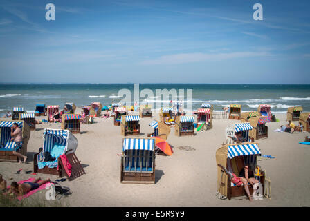 Holiday Makers at Neindorf beach, Niendorf is a traditional German holiday location on the Baltic Coast in Northern - Stock Photo