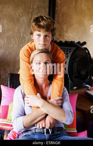 12 year old child with his mother. - Stock Photo
